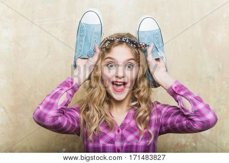 Amazed Pretty Girl With Blue Fashion Sneakers In Hands
