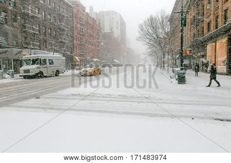 New York, February 9, 2017: Scene on the corner of Columbus Avenue and 68th street during a heavy snowfall.