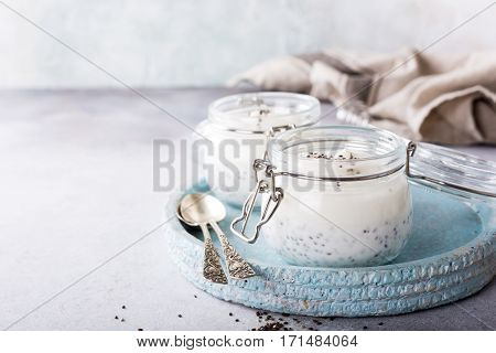 Chia seed pudding in glass jar. Superfoods concept with copy space.