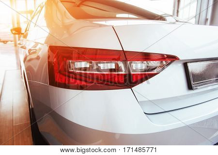The headlights and the hood of a sports car