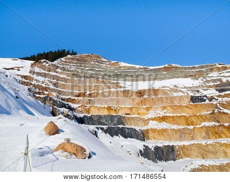 Old mountain stone quarry in Tirol Alps near Fieberbrunn, Austria, Europe.