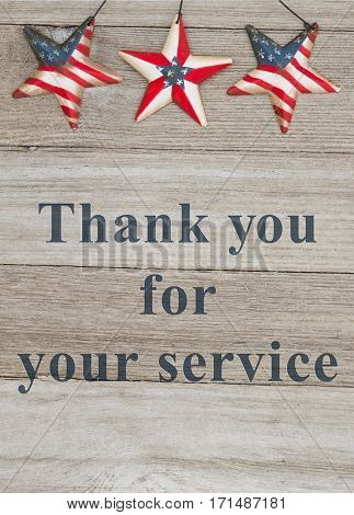 USA patriotic thank you message USA patriotic old flag on a stars with weathered wood background with text Thank you for your service