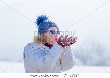 Winter woman blowing snot in the air