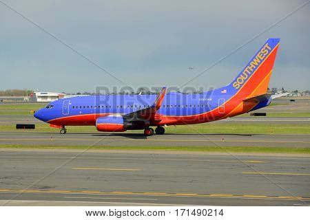 BOSTON - MAY. 6, 2014: Southwest Airlines Boeing 737-700 taxiing at Boston Logan International Airport, Boston, Massachusetts, USA.