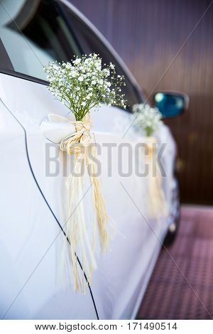 Car decorated with flowers on wedding day