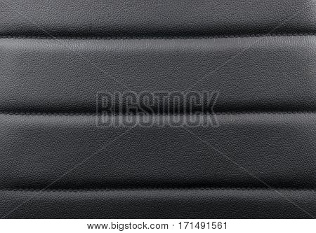 Black leather texture background with stitching, close up