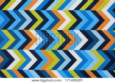 blue orange yellow striped colored gift paper