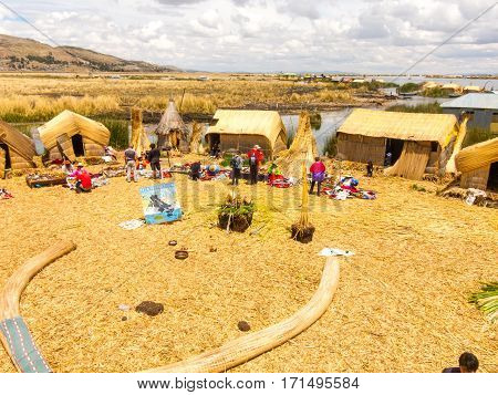 Puno, Peru - December 10, 2011: Several Tourists Souvenir Shopping from Uros on floating islands