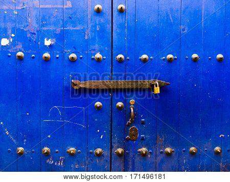 Heavy and old blue door in Cusco, Peru