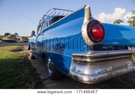 Blue oldtimer taxi rear view in Cuba