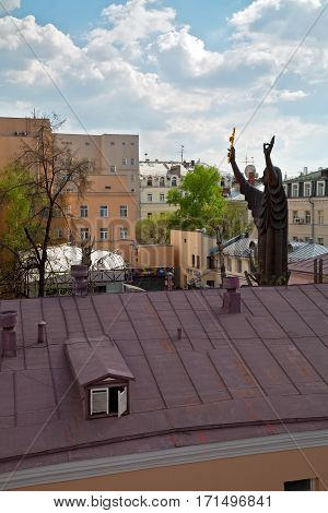 MOSCOW/ RUSSIA - APRIL 30. Top view of the huge sculpture of a praying woman and buildings arou