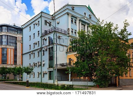 MOSCOW/ RUSSIA - JULY 16, 2015. Modern building and old house with a lot of air conditioners on the facades. Ozerkovskiy lane, Moscow, Russia