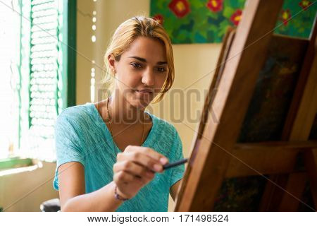 School of art college of arts education for young students. Happy young woman smiling learning to paint for job profession hobby