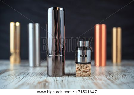 Electronic Cigarette And Liquid Tank On The Table. Mechanical Mod. Ends.
