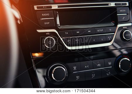 Car audio system front panel. of beautiful modern car close up in the cabin.
