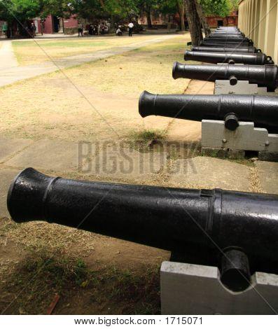 Row of cannons at Fort Jesus Mombasa Kenya poster