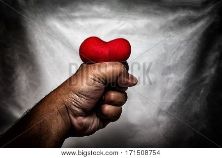 Angry Man Crushing Red Heart In Hand., Unrequited Love., Love Concept For Valentines Day., In Dark T