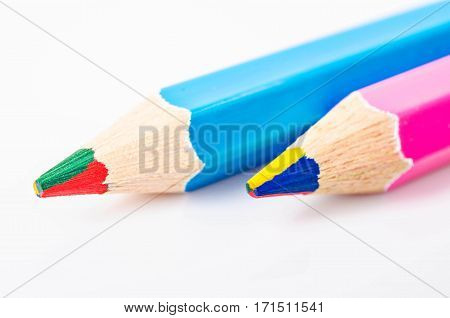 Close up multicolor wooden pencil in one or rainbow color pencil on white background.