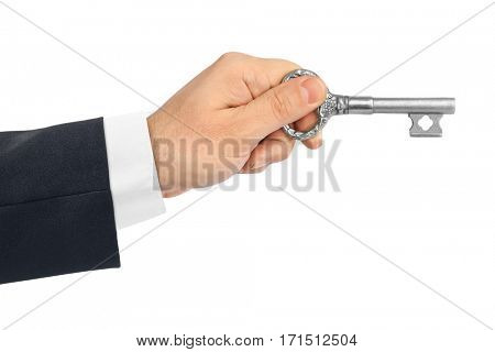 Hand with retro silver key isolated on white background
