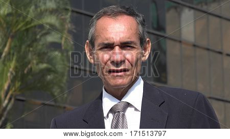 Older Businessman Or Executive Wearing Business Suit