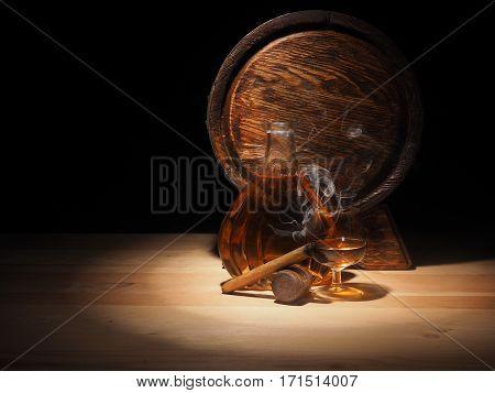 Glass Of Cognac , Cigar And Old Oak Barrel