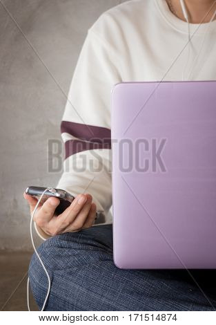 Woman sitting on the floor using laptop stock photo