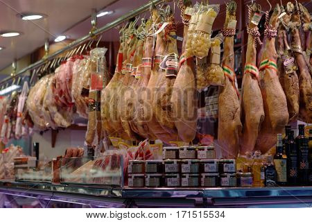 BARCELONA, SPAIN - JANUARY 9, 2013: Jamons, sausages, and other meat products in a shop. Traditional Spanish jamon is widely known in the world