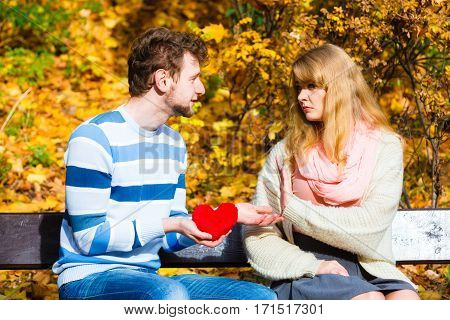 Man Confess Love To Girl On Bench In Park.