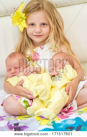 newborn baby and sister at home, indoor portrait
