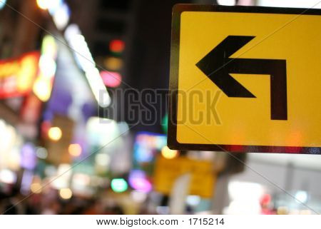 Yellow Sign With Arrow