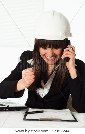 Girl Sitting In The Construction Helmet