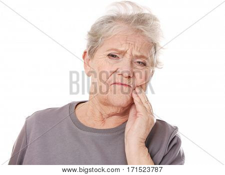 Elderly woman suffering from toothache on white background