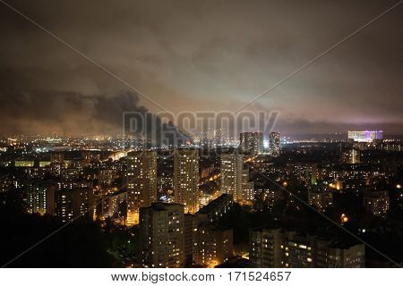 Smoke and fire in residential area in Moscow at autumn night