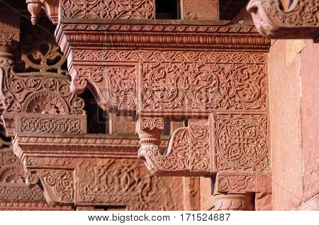 AGRA, INDIA - FEBRUARY 14: Columns with stone carving in Agra Fort, UNESCO World heritage site in Agra. Uttar Pradesh, India on February 14, 2016.