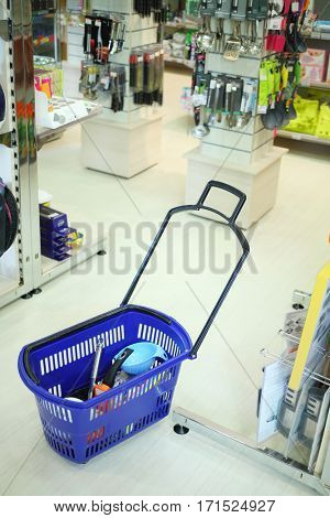 Shopping cart in supermarket Goods for Home with modern dishes