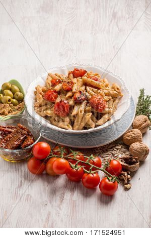pasta with dried tomatoes green olives and sicilian pesto