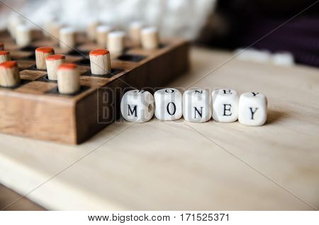 Business money word collected of elements of wooden elements with the letters money and board game
