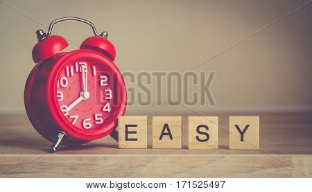 easy work writen on wood block decoration with red modern alarm clock