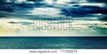 blue ocean sea with moody before strom sky background