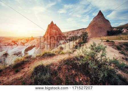 TUnique geological formations in valley in Cappadocia.