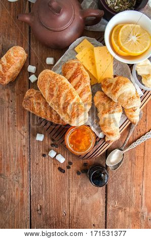 Fresh puff pastry baking. Wooden background. Breakfast concept.