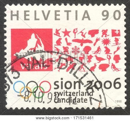 MOSCOW RUSSIA - CIRCA JANUARY 2017: a post stamp printed in SWITZERLAND shows Matterhorn pictogram & Olympic Rings circa1998