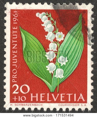 MOSCOW RUSSIA - CIRCA JANUARY 2017: a post stamp printed in SWITZERLAND shows Lily-of-the-valley (Convallaria majalis) the series
