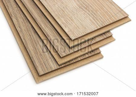 Laminate plates imitating oak wood on a white background