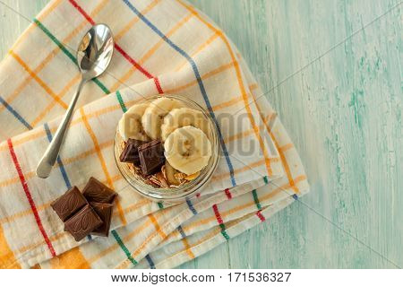Banana And Muesli In A Jar Rustic Background