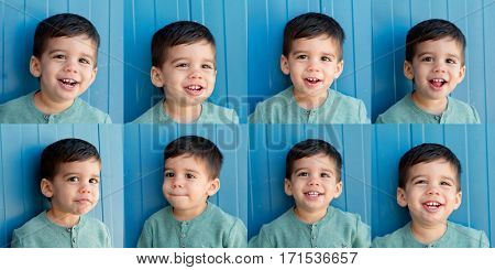 Eight portraits of a funny child with diferents expresions on blue background