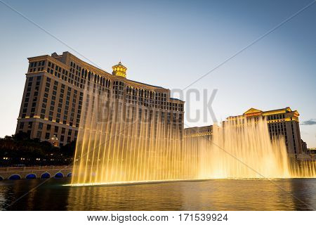 Water fountain musical show by Bellagio Hotel and Casino in Las Vegas. Viewed from the Las Vegas Strip at dawn on May 2014.