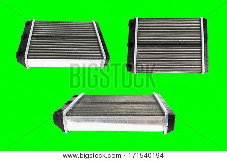 Many engine cooling radiators isolated on green background. Auto spare parts for passenger car. Chromakey