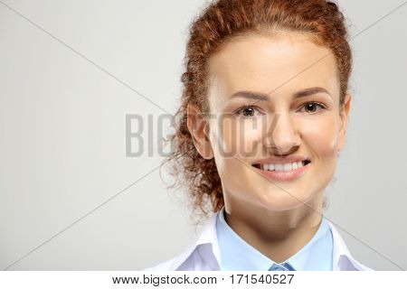 Young woman on grey background