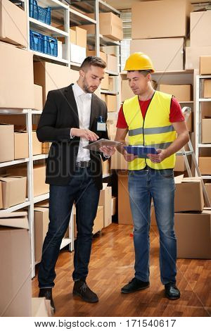 Business people working at warehouse